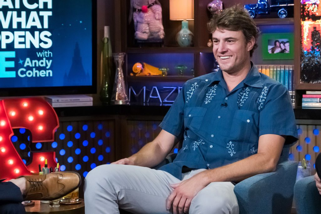 'Southern Charm' star Shep Rose is sitting in a chair.