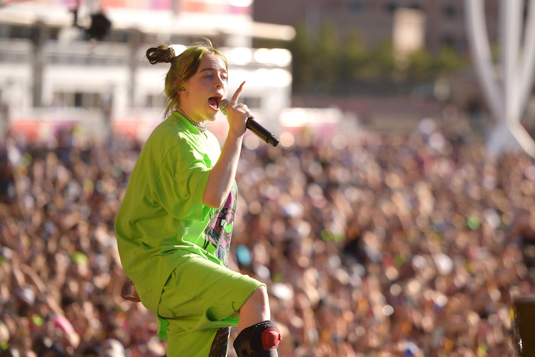 Billie Eilish performs a song onstage.
