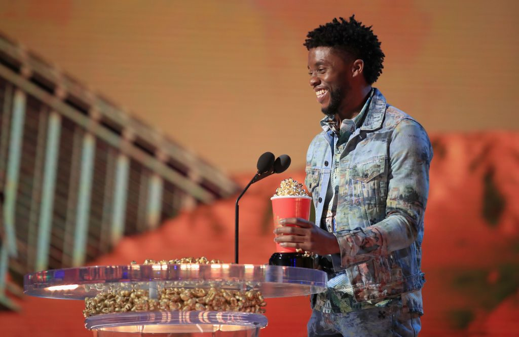 Chadwick Boseman accepting an award for Black Panther at the MTV Movie and TV awards