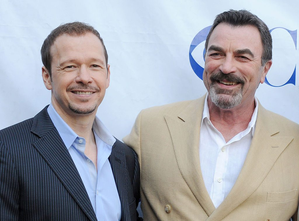 Donnie Wahlber and Tom Selleck | Gregg DeGuire/WireImage