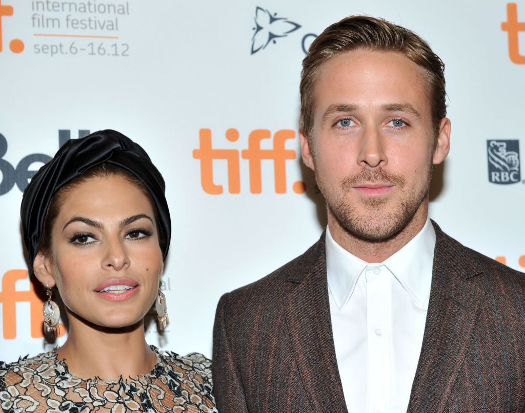(L) Eva Mendes and (R) Ryan Gosling attend a red carpet premiere