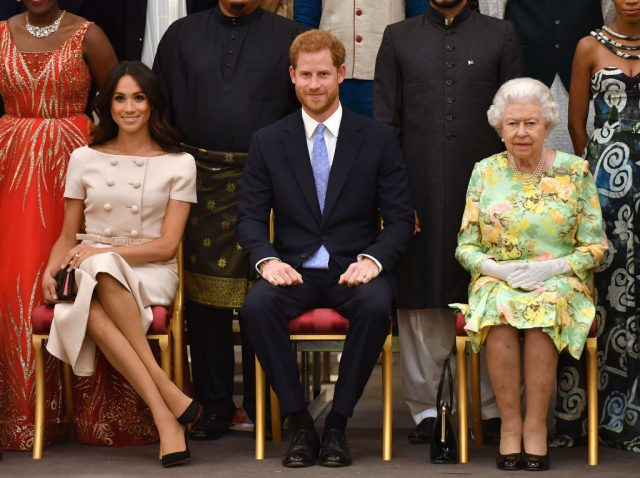 Prince Harry and Meghan Markle beside Queen Elizabeth