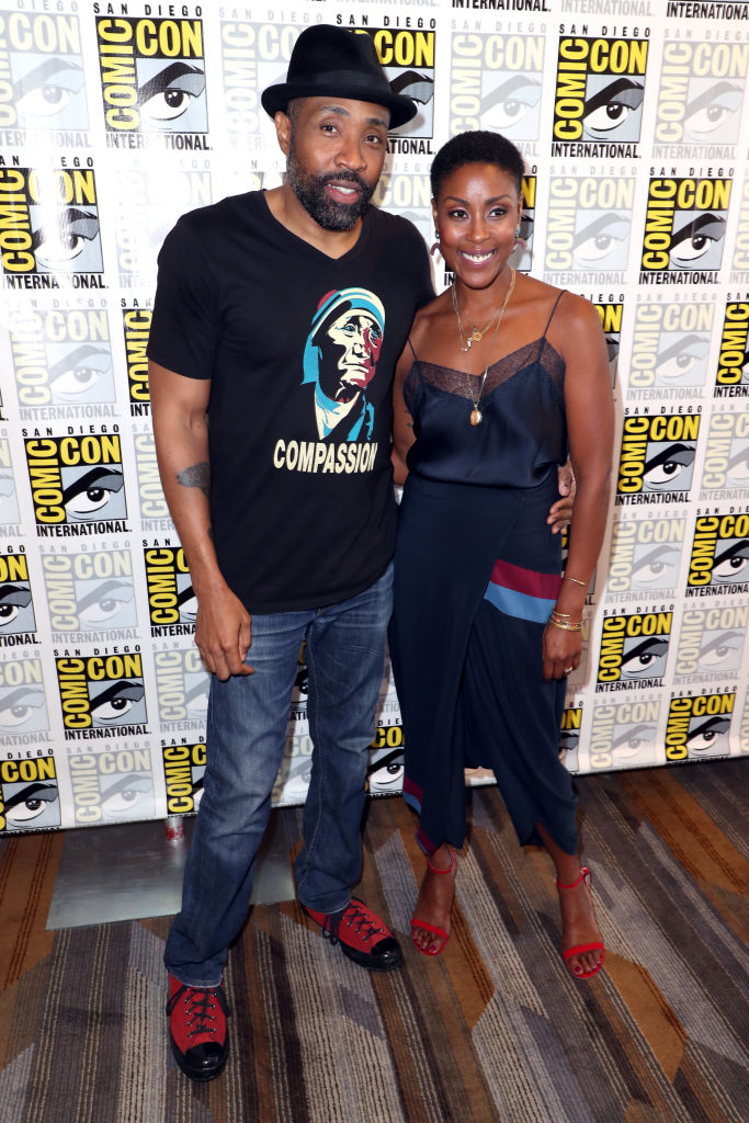 Cress Williams and Christine Adams promoting Black Lightning at Comic Con
