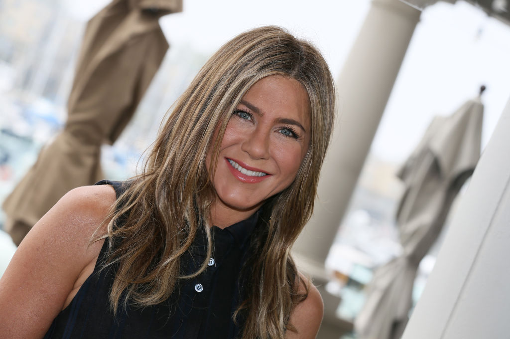 Jennifer Aniston speaking at a press conference