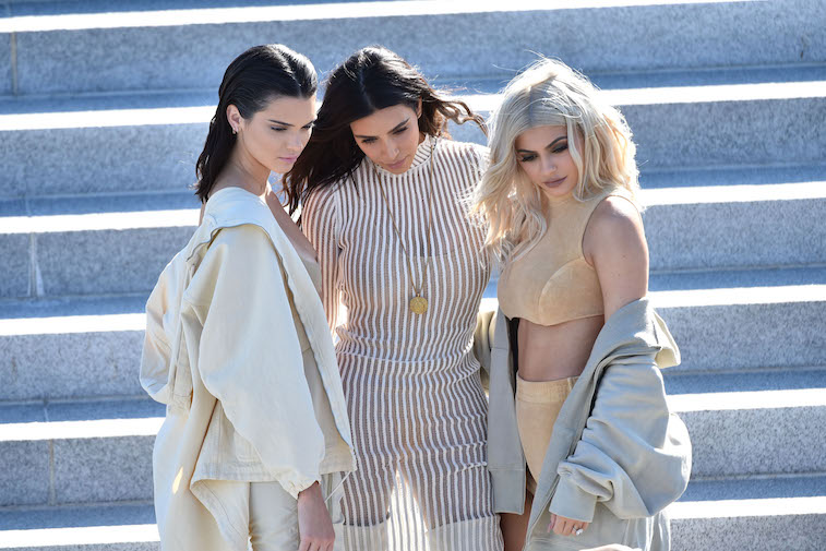 Kendall Jenner, Kim Kardashian and Kylie Jenner attend the Kanye West Yeezy Season 4 fashion show