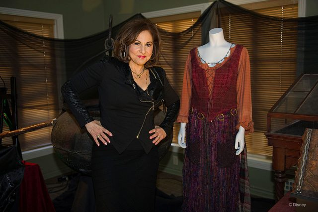 Kathy Najimy stands next to Mary Sanderson costume from 'Hocus Pocus.'