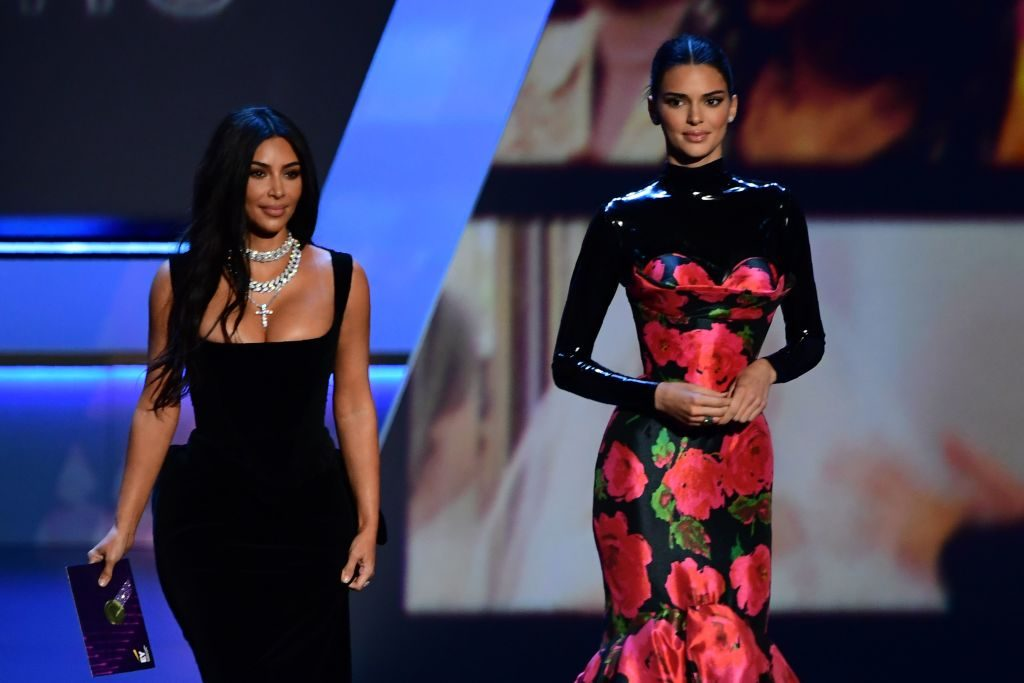 (L) Kim Kardashian and (R) Kendall Jenner react after being laughed at during the 2019 Emmy Awards