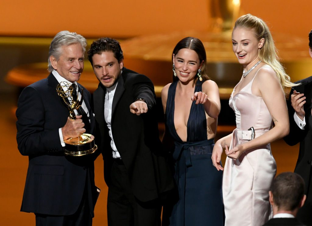 Michael Douglas presents the Outstanding Drama Series award for 'Game of Thrones' to Kit Harington, Emilia Clarke, and Sophie Turner onstage during the 71st Emmy Awards