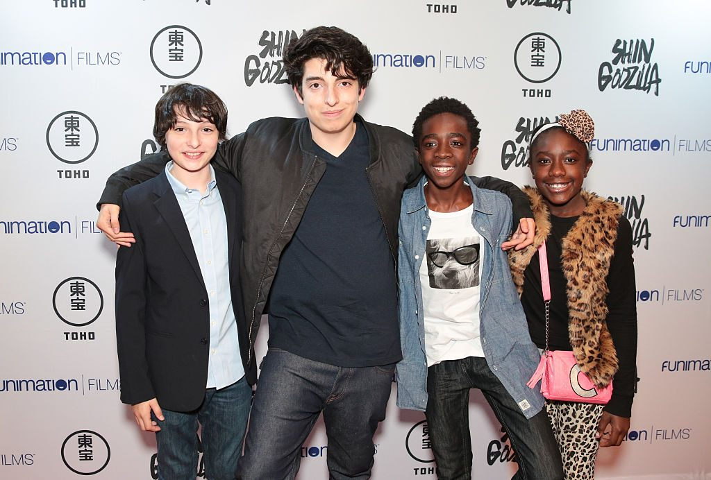Nick Wolfhard with members of the Stranger Things cast, including brother Finn Wolfhard