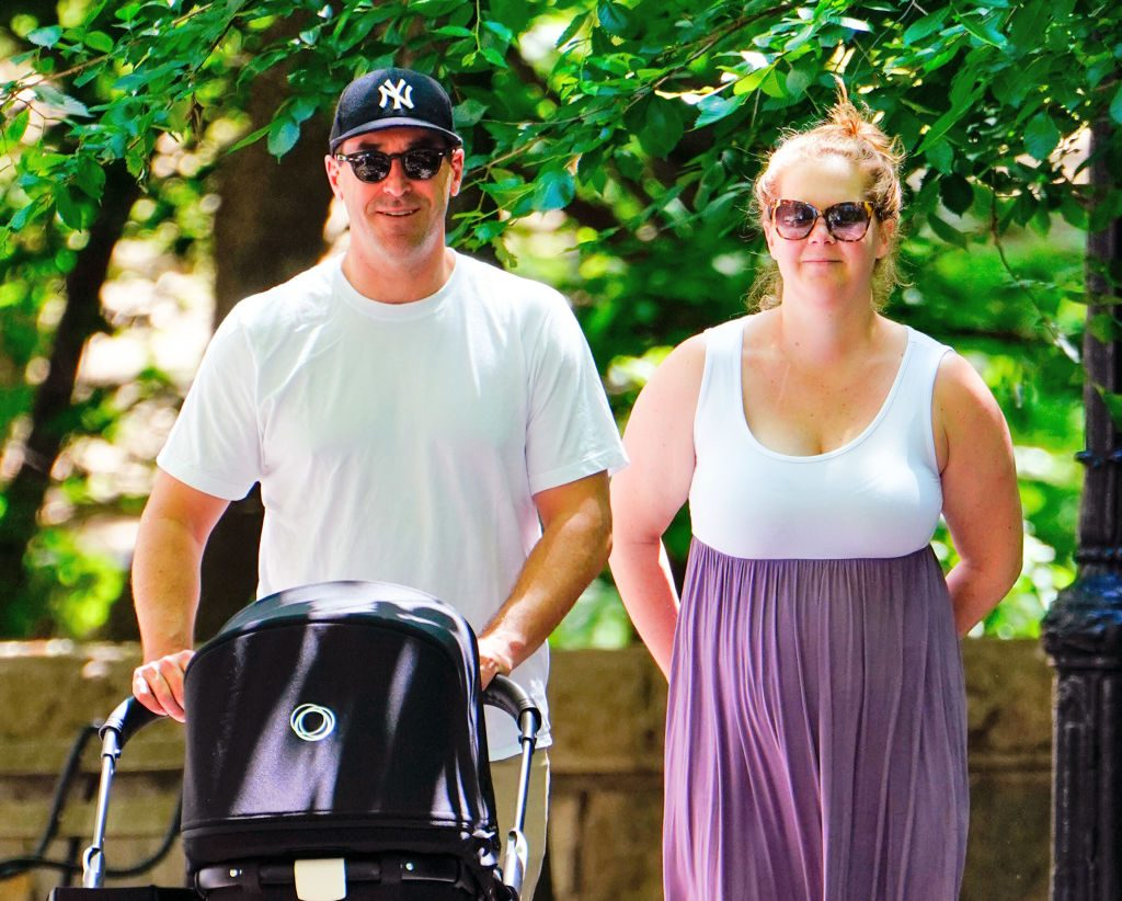Amy Schumer and husband walking in Central Park with son