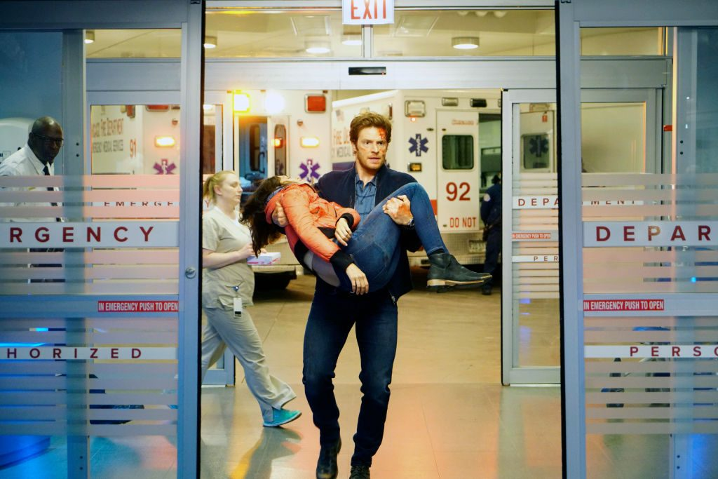 Will Halstead carries person into hospital on Chicago Med