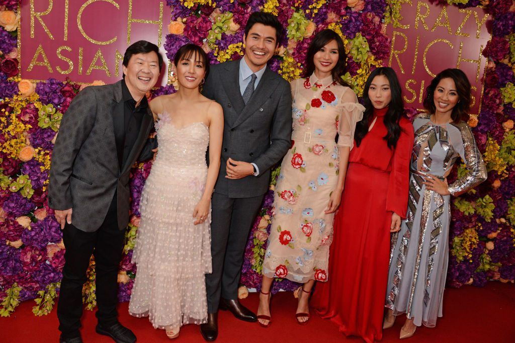 """(L-R): Ken Jeong, Constance Wu, Henry Golding, Gemma Chan, Awkwafina and Jing Lusi of """"Crazy Rich Asians"""""""