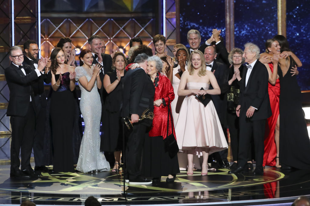 The cast and crew of The Handmaid's Tale accepts the Emmy Award for Outstanding Drama Series at the 69th Emmys in 2017