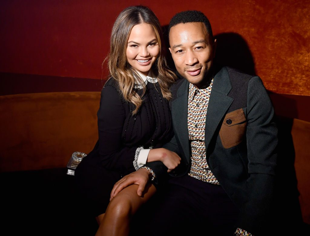 Chrissy Teigen and John Legend at a Paris Fashion Week aftershow party.