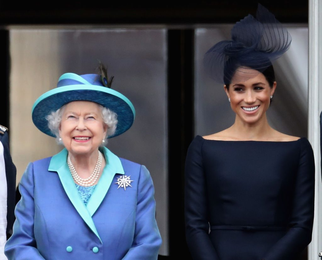 Queen Elizabeth II and Meghan Markle watch the RAF flypast on the balcony of Buckingham Palace.
