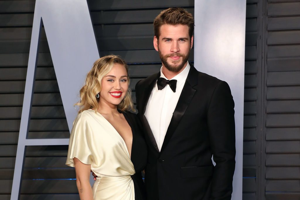 Miley Cyrus and Liam Hemsworth attend a 2018 Vanity Fair Oscar Party.