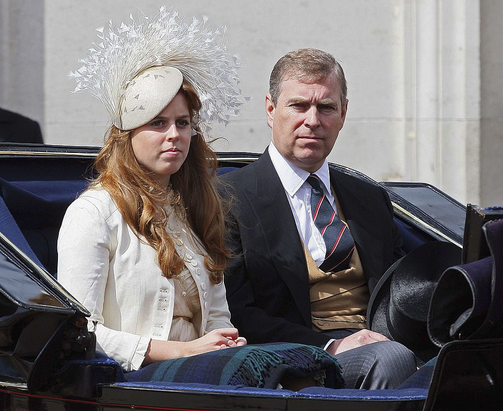 Prince Andrew, Duke of York sits next to his daughter Princess Beatrice.