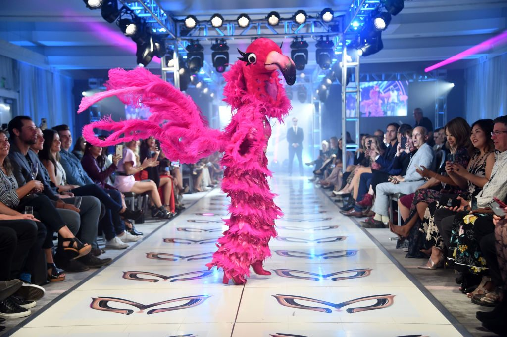 The Flamingo, a character from season 2 of 'The Masked Singer' walks down the runway during the character costume reveal event