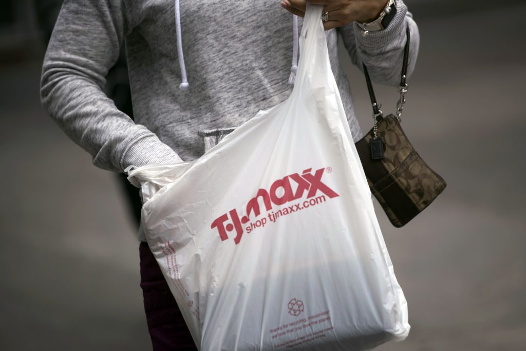 a woman holding a tj maxx shopping bag