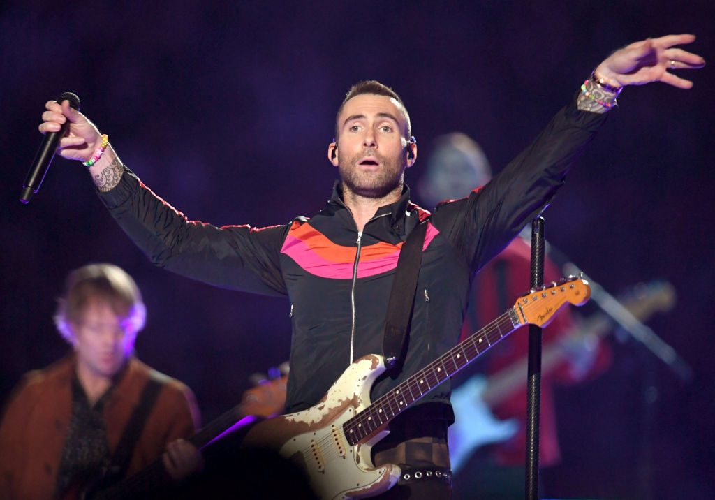 Adam Levine is performing on stage
