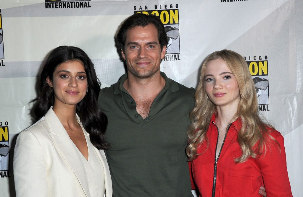 The Witcher cast (Anya Chalotra, Henry Cavill, Freya Allan) at Netflix's The Witcher panel during Comic Con 2019