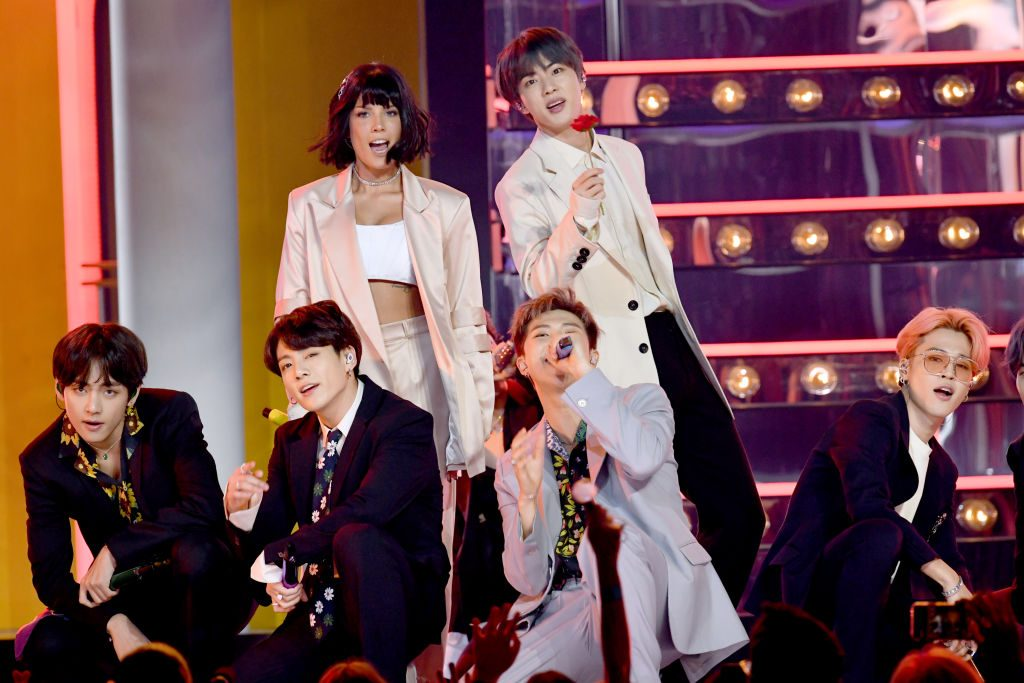 Halsey and Jin of BTS perform onstage