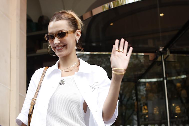 Bella Hadid waving to the camera while walking in Paris