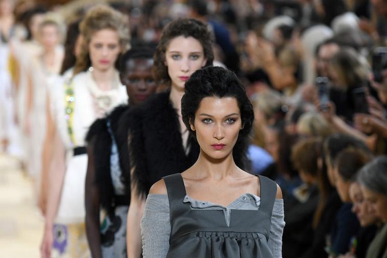 Bella Hadid walking the runway at a fashion show
