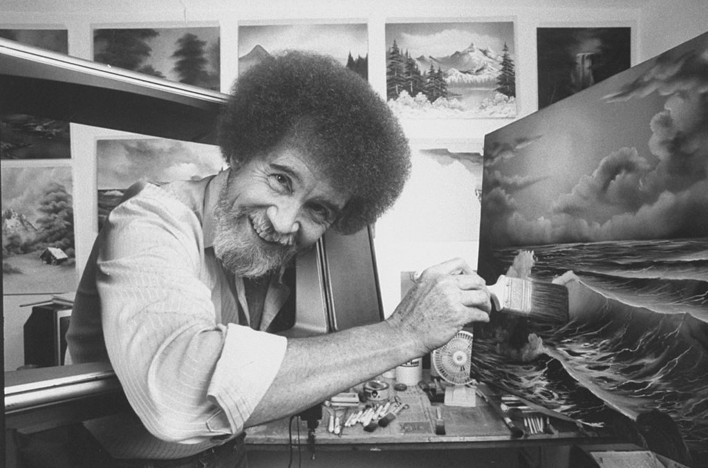 Bob Ross painting a seascape in his studio at home