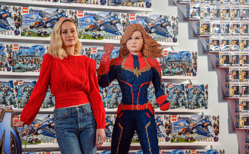 Brie Larson with a Lego Captain Marvel.