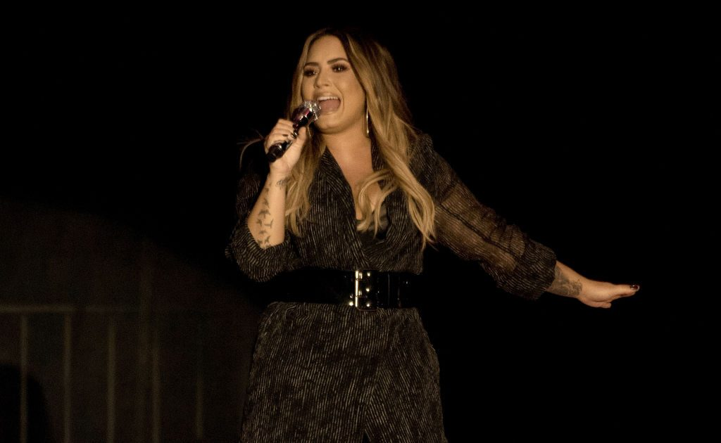 Demi Lovato singing on stage