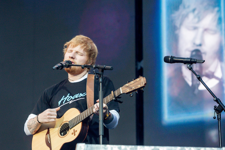 Ed Sheeran performing onstage