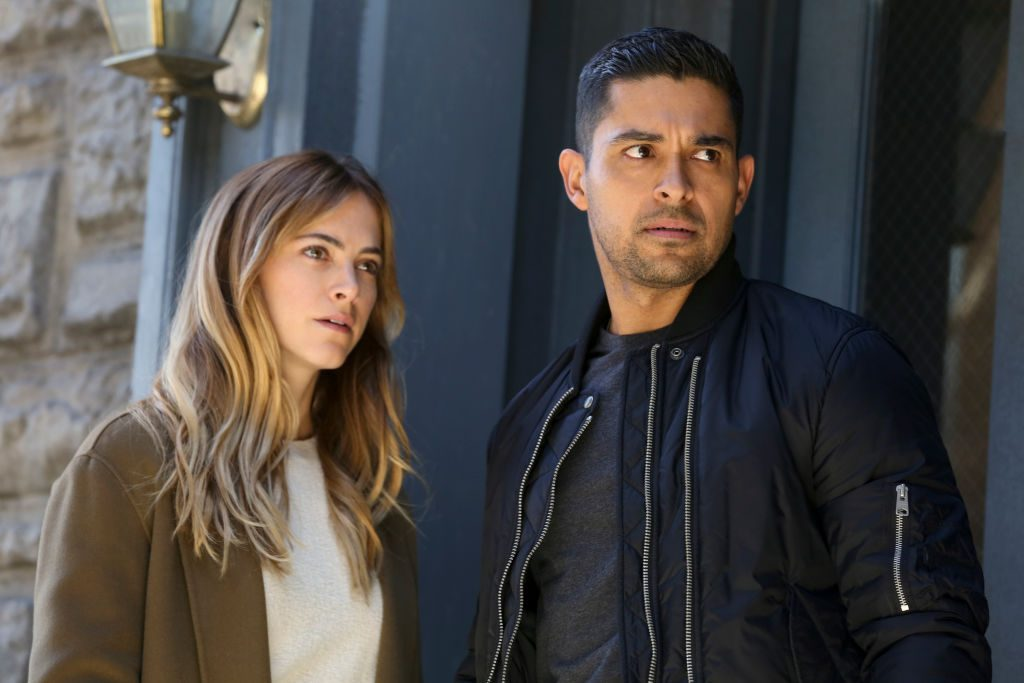 Emily Wickersham with Wilmer Valderrama on the set of NCIS | Michael Yarish/CBS via Getty Images