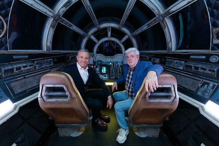 Bob Iger and George Lucas on the Millennium Falcon