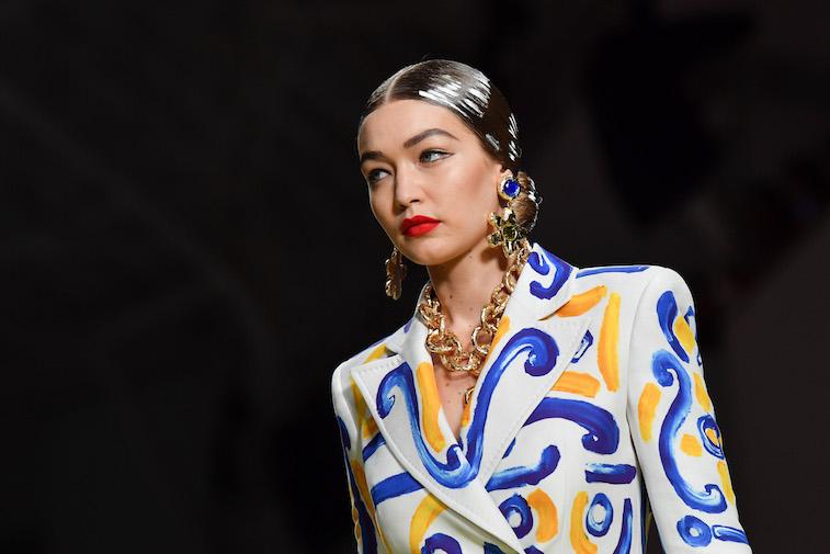 Gigi Hadid walking down a fashion show runway