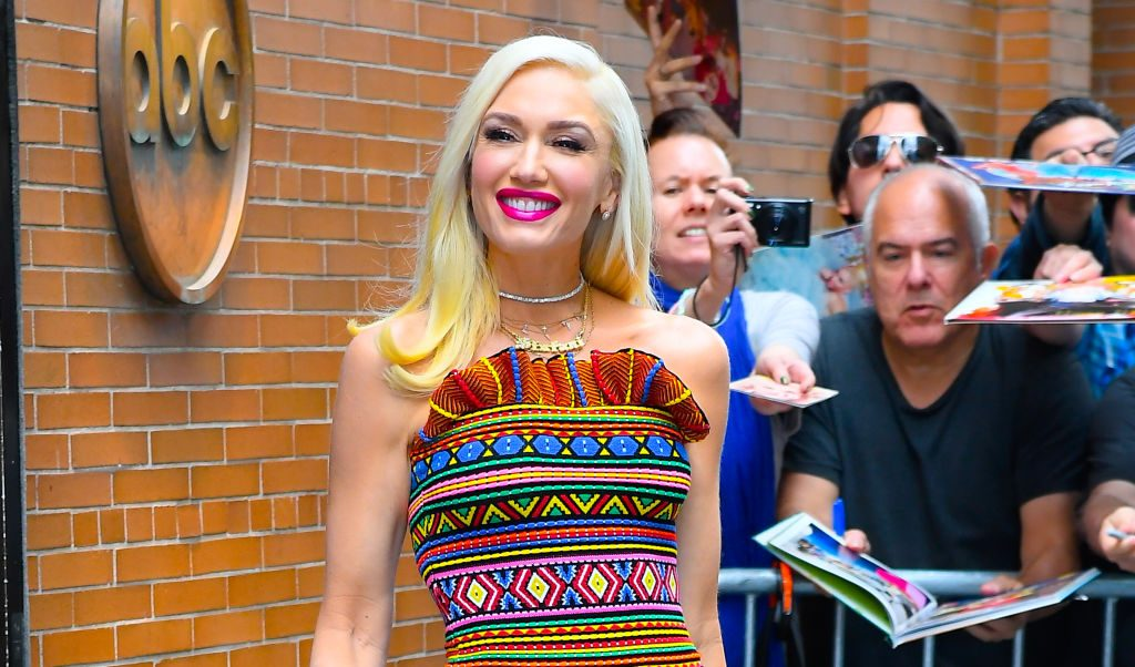 Gwen Stefani is smiling