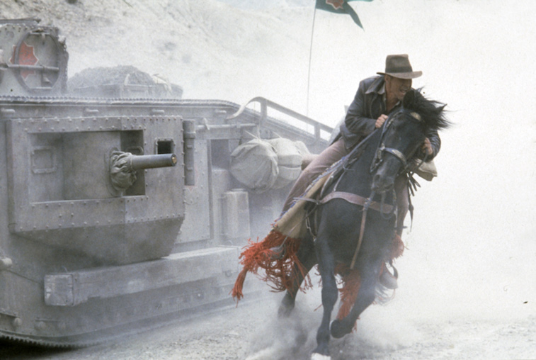 Harrison Ford riding a horse as Indiana Jones
