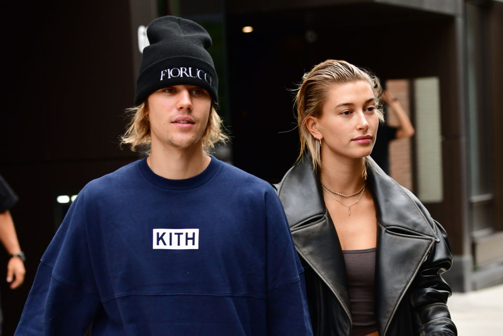 Justin and Hailey Bieber walking down the street