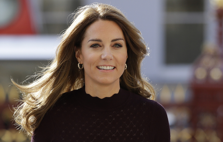 Kate Middleton smiles at the camera