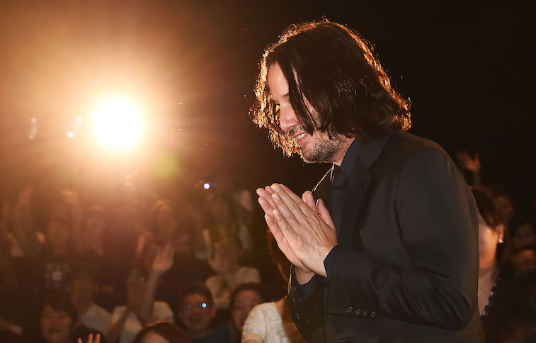 Keanu Reeves greeting crowds onstage