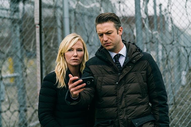 "Kelli Giddish as Detective Amanda Rollins and Peter Scanavino as Dominick ""Sonny"" Carisi"