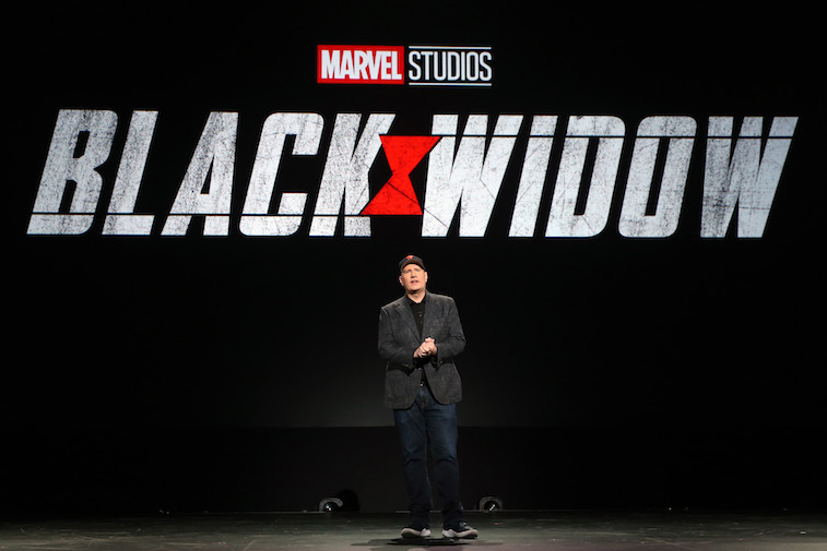 Kevin Feige speaking onstage at D23