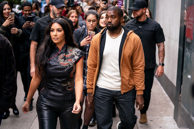 im Kardashian and Kanye West walk down the street in New York