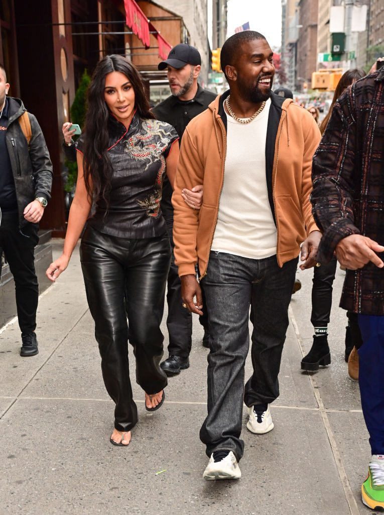 Kim Kardashian West and Kanye West walk along 57th Street