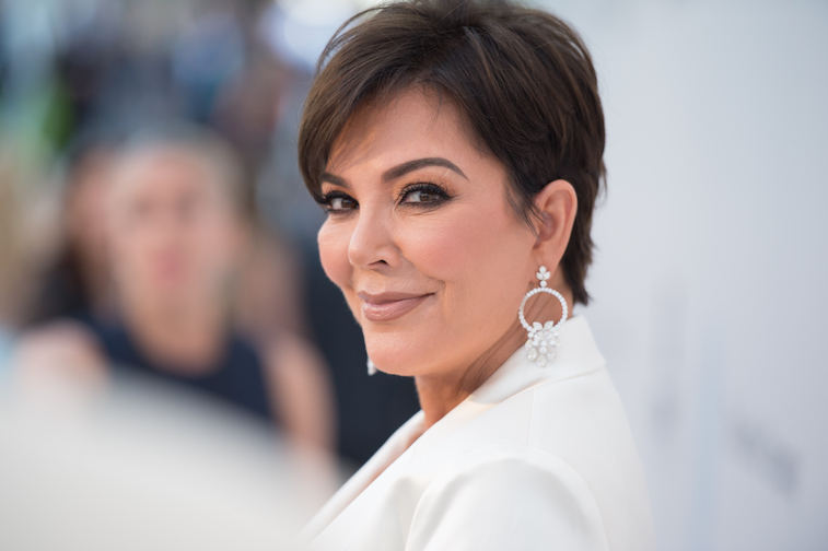 Kris Jenner smiles and poses for a photo