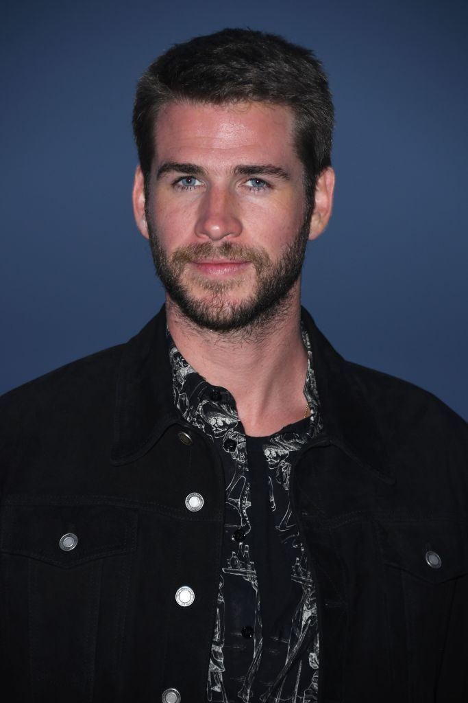 Australian actor Liam Hemsworth arrives for the Saint Laurent Men's Spring-Summer 2020 runway show in Malibu,