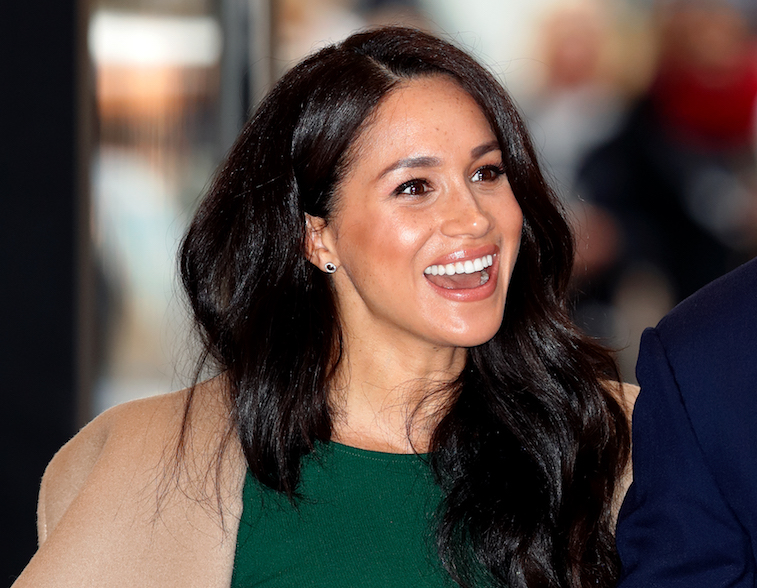 Meghan Markle smiling for the camera