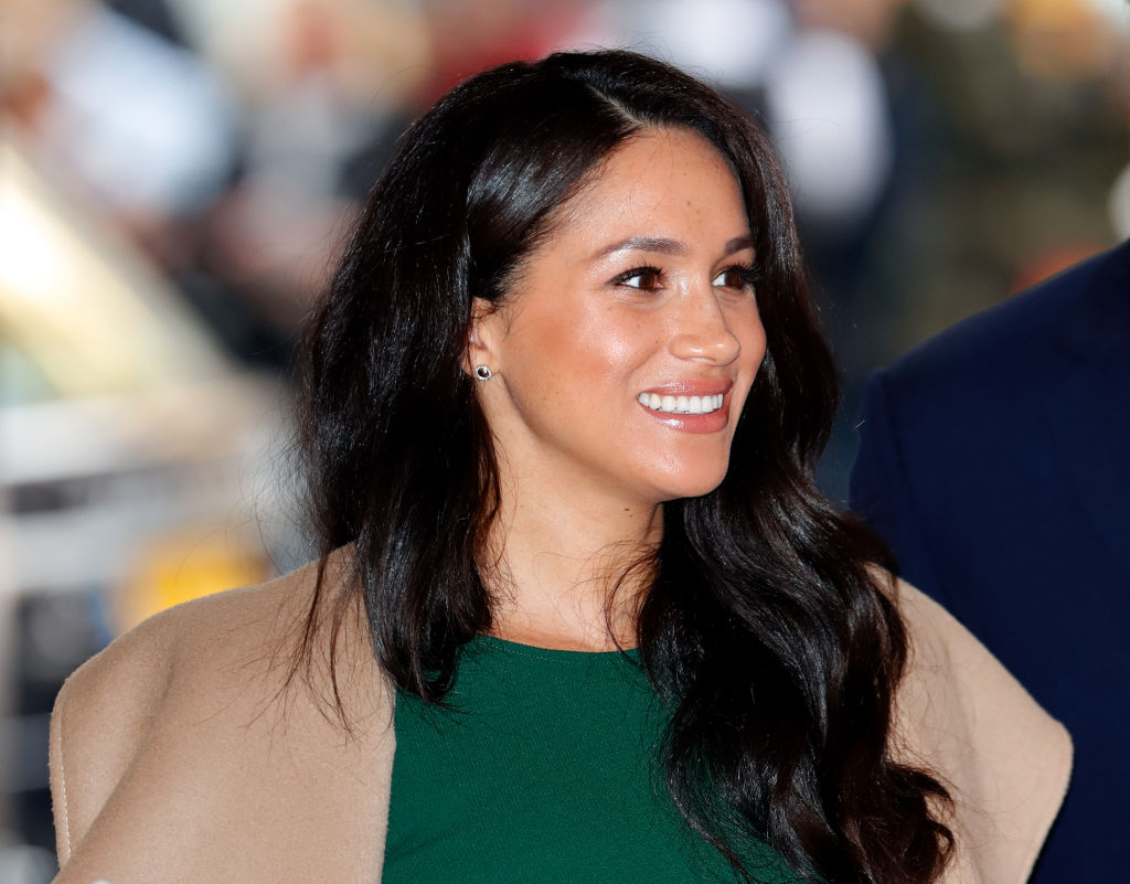 Meghan Markle smiles at the camera