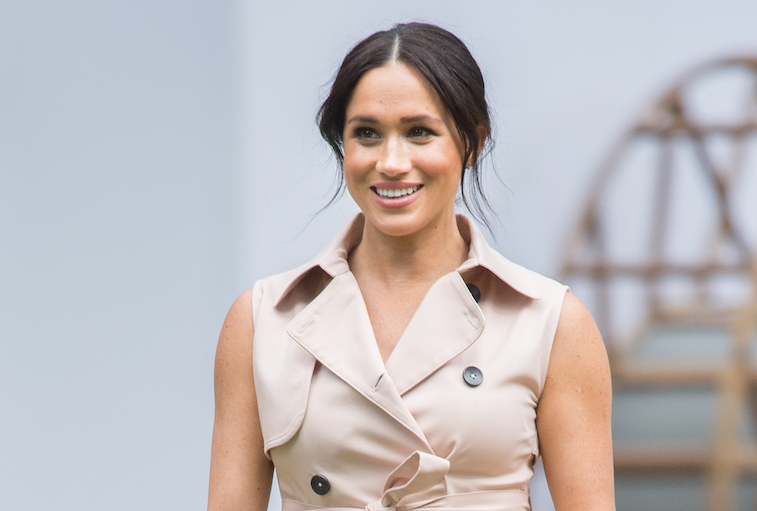 Meghan Markle smiling at the camera