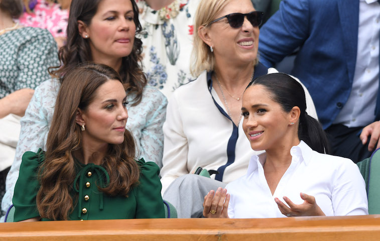 Meghan Markle and Kate Middleton sit togehter